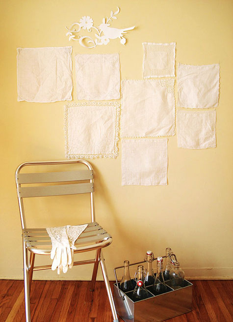 Vintage linen handkerchiefs displayed on wall