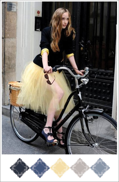 Color board based on yellow, black, grey slate blue, navy, bicycle, skirt